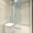 70_BUILT IN toilet, BUILT IN shower_white_des. V. Ambroz_Corian®